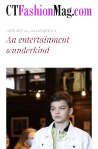 """Austin walking in a fashion show from the Magazine feature post, titled """"An entertainment wunderkind"""""""