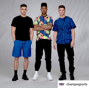 Photo of Kyle with two other models wearing Champ Sports attire