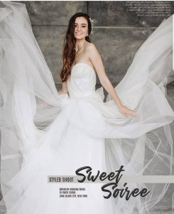 image of Natalie modeling in Betrothed Magazine wearing a wedding dress that is blowing upwards in all directions