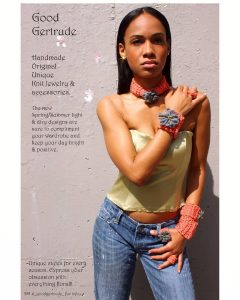 Olivia modeling in a print ad for Good Getrude posing and showing off the brand's jewelry