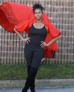 body shot of Chelsea modeling a red flowing cape