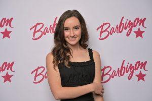 headshot of Abigail with a Barbizon background