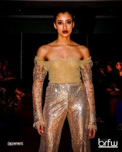 modeling shot of Khadija Assabar on the runway at Onaofakind BR Fashion Week