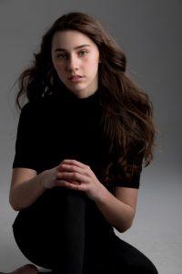 head shot of Ella Jones wearing all black
