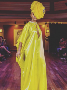 Shot of Breyanne in an avant garde yellow dress on the runway