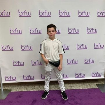 Photo of Austin posing at Baton Rouge Fashion Week