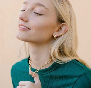 Calista modeling a gold chain for Amanda Deer Jewelry