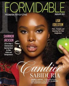 Cover of Formidable Woman Magazine March April 2021 issue with Candice as the cover model posing with a green apple