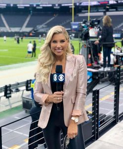 Melanie reporting on the sidelines