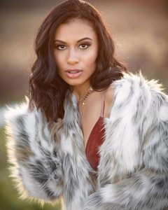 Modeling photo of Savannah in a fur coat