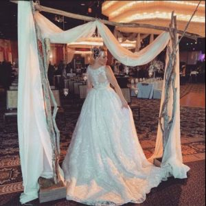 Alana wearing a bridal dress modeling at an event