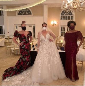 Red Bank models modeling bridal fashions at the show
