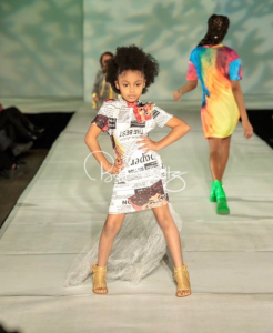 young Barbizon Red Bank model posing on the runway at Atlantic City Fashion Week