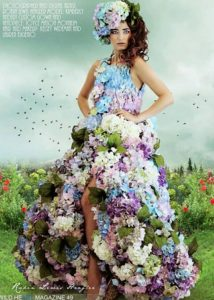 shot of Kimberly modeling in a colorful floral dress from the Wildheart Magazine editorial