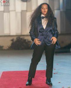Cruz modeling the runway in a high fashion tuxedo