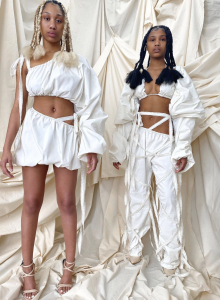 Brelyn and Brooke modeling in white deconstructed clothing