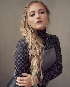 headshot of Anna with a fishtail hair fashion