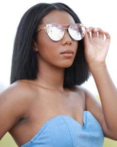 modeling head shot of Amariah showing off sunglasses