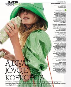 Glamour Hungary magazine tear featuring Nikayla Novak modeling in a green rain outfit