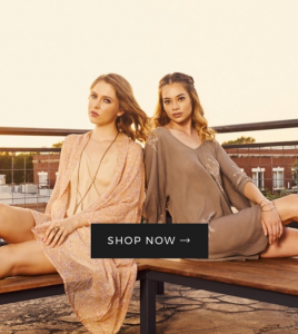 Bekah modeling for an online campaign with another woman seated back to back