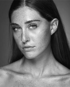 black and white headshot of Gianna Guzzo looking serious