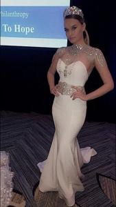 Gina Vvulaj, Barbizon of Detroit grad, booked a modeling job at th charity event Zaman for fashion designer Katerina Bocci