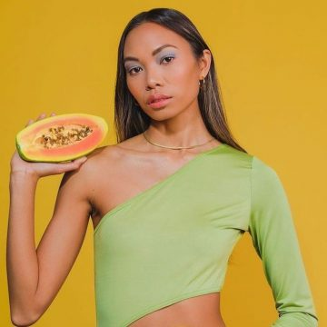 Barbizon model Lauralee Penafuerte modeling in a green leotard with a papaya