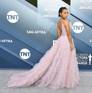 Logan Browning at an Awards Show in Long Pink Gown