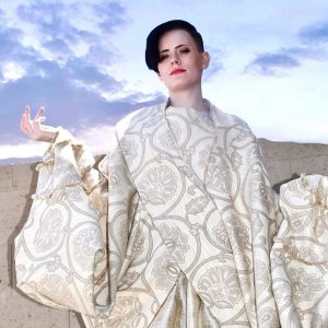 Onyx modeling in a large tapestry garment for the editorial
