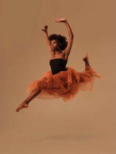 saskia dancing in a mid air shot of her jumping elegantly