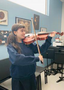 Tiffany playing the viola