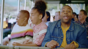 Still of Zariah, older woman, and Keenan Thompson riding a tram