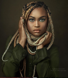 modeling shot of Chatayana with an intense look and brightly colored braided hair