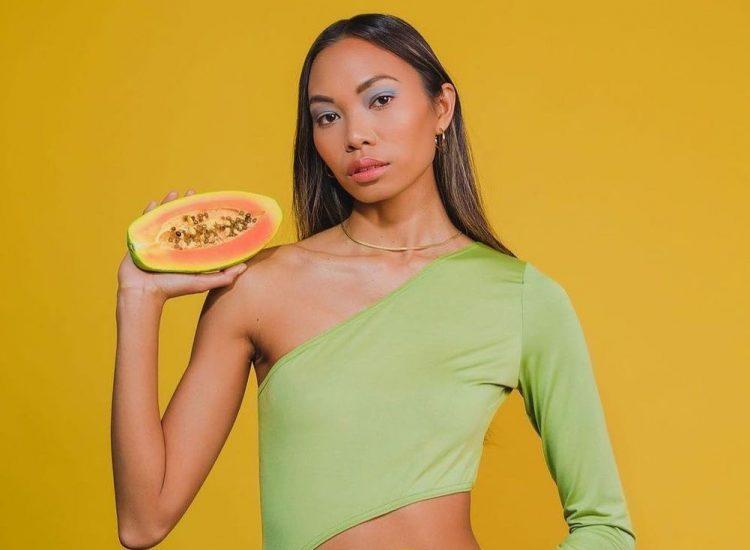 Barbizon model Lauralee Penafuerte modeling in a green leotard with a papaya